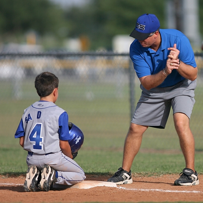 Baseball coach talking to player